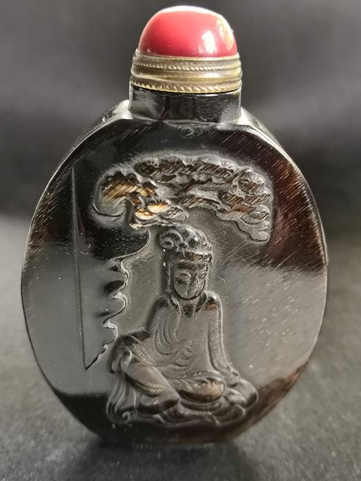 Snuff Bottle with Guan Yin, mythical creatures and coins
