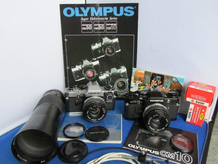 Olympus Om 10 Quartz + 50mm +  Om 10 + 50mm + 400mm + book + film