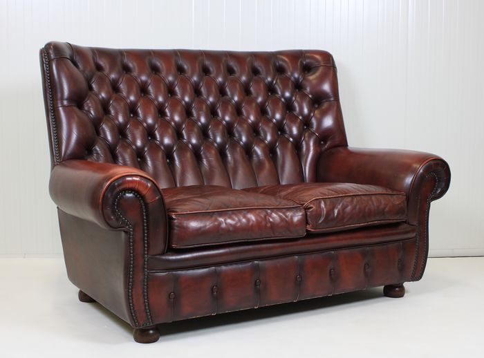 Chesterfield - Burgundy Chesterfield Style two-seater lounge sofa