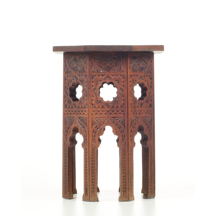 Side table, or plant table with carvings
