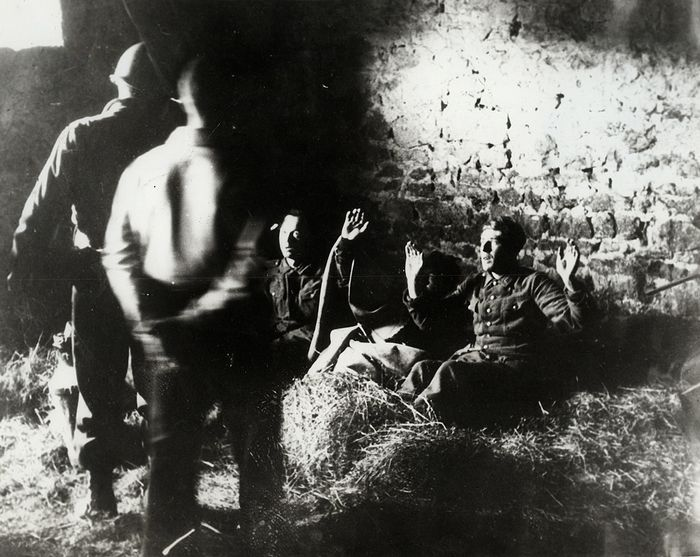 Attributed to Frank J. Scherschel (1907-1981)/Associated Press - Wounded German Soldiers Surrender in Barn, Normandy, 1944