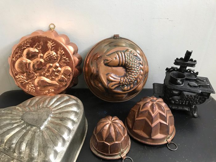 Various shapes and a miniature stove - Copper, tin and cast iron