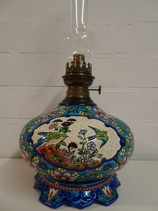 Emaux de Longwy - Large petroleum lamp with a decor of birds and flowers