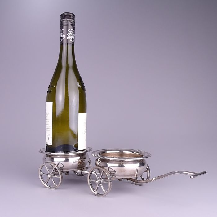 Silver-plated double wine bottle holder, shaped like a pull cart. - Brass, Silverplate