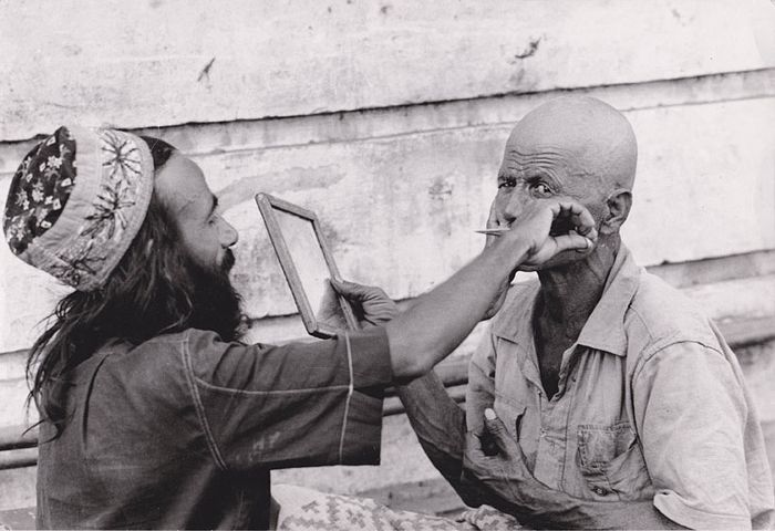 Paris Match - Barber trimming beard of a client, India, 1966