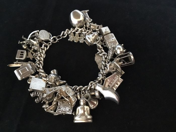 800 Silver - Silver vintage charm bracelet with 38 charms