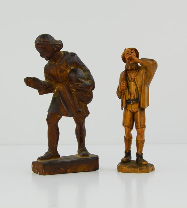 Woman Statue and Woodcutter Statue