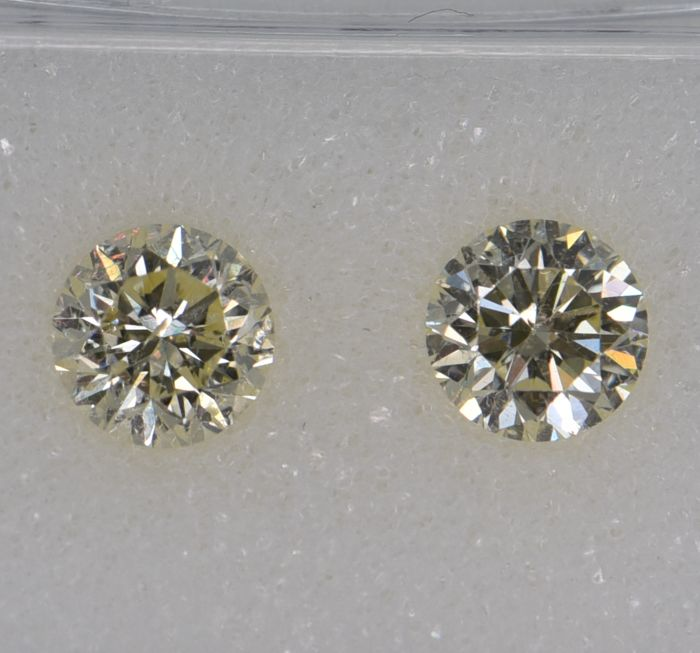 2 pcs Diamond - 1.17 ct - Round - light yellow - SI1, VVS1