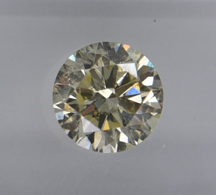 1 pcs Diamond - 0.64 ct - Round - light yellow - SI2