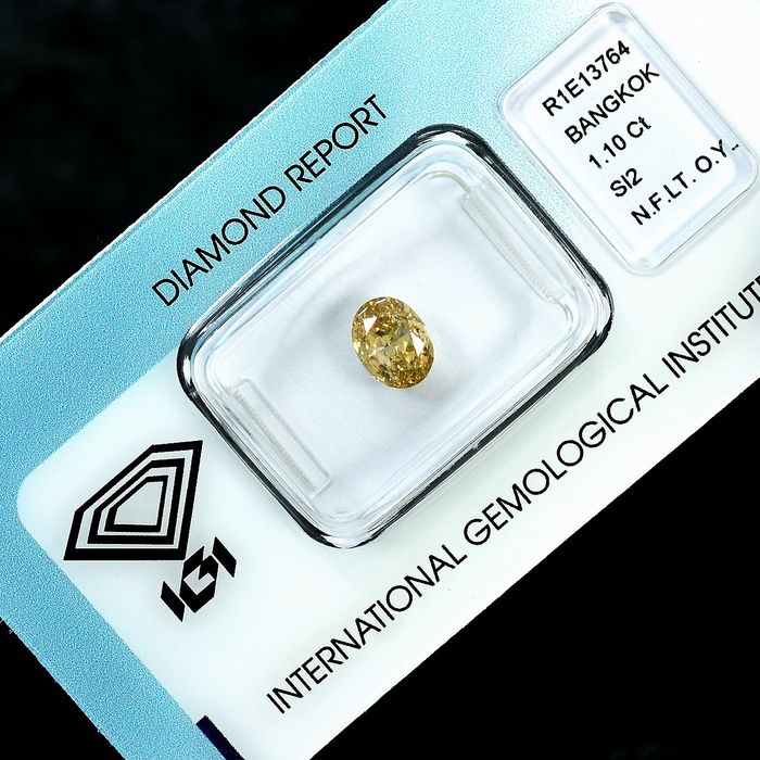 Diamant - 1.10 ct - Oval - Natural Fancy Light Orange - Yellow - Si2 - NO RESERVE PRICE