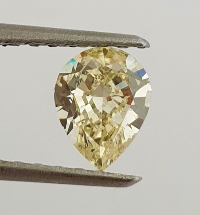 Diamante - 0.62 ct - Pera - Natural Fancy Light Yellow - VS1