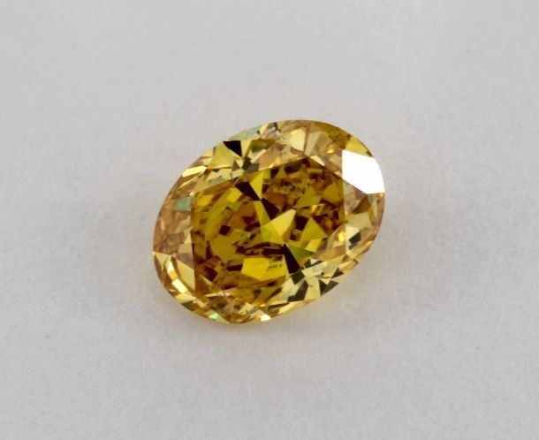 1 pcs Diamond - 0.72 ct - Oval - fancy vivid orange yellow - SI1