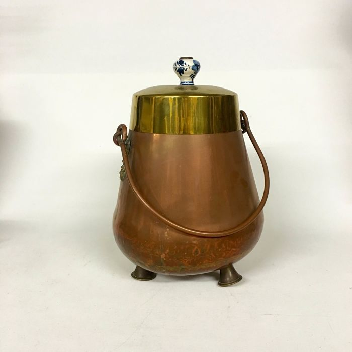 A beautiful, heavy quality, antique extinguishing pot - copper and brass