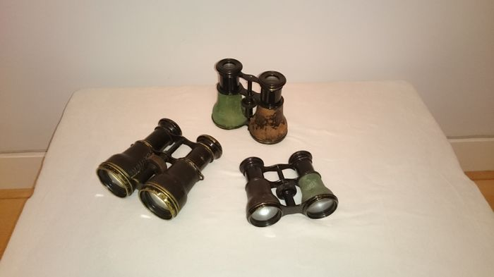 Binoculars (3) - Copper, leather, iron and plastic or bakelite