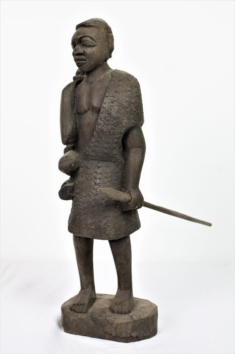 African hunter with loot. Carvings - Wood