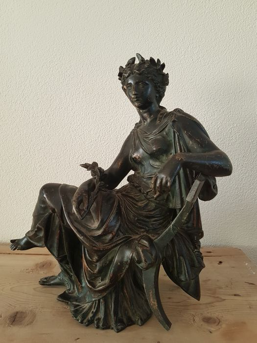 A statue of Demeter, the Greek goddess of the harvest and ...