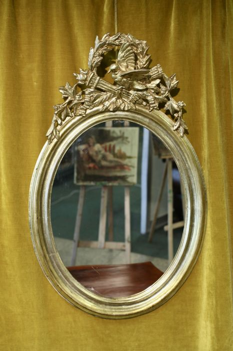 Large Oval gold-plated wall mirror with large crest - - plaster, wood - 19th century