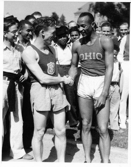 Unknown/ACME - Jesse Owens as he meets with USC star Foy Draper, 1935