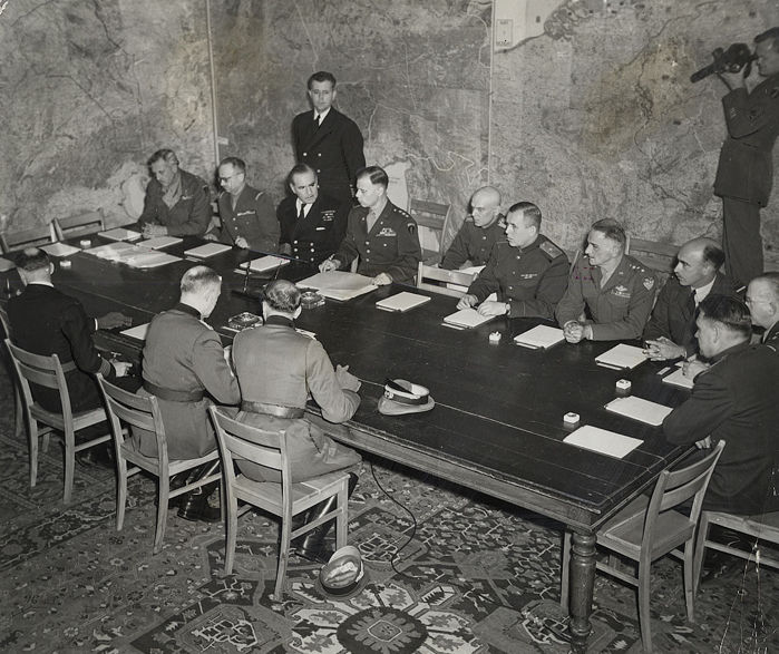 Unknown/US Army - Germany signs surrender, Reims, France, 1945