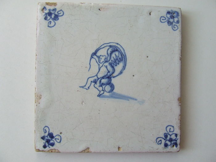 Antique tile with a Kitesurfing Cupid. - Ceramic