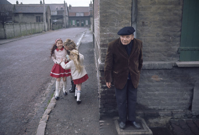 John Bulmer (1938-)  - France, Old man and children, 1966