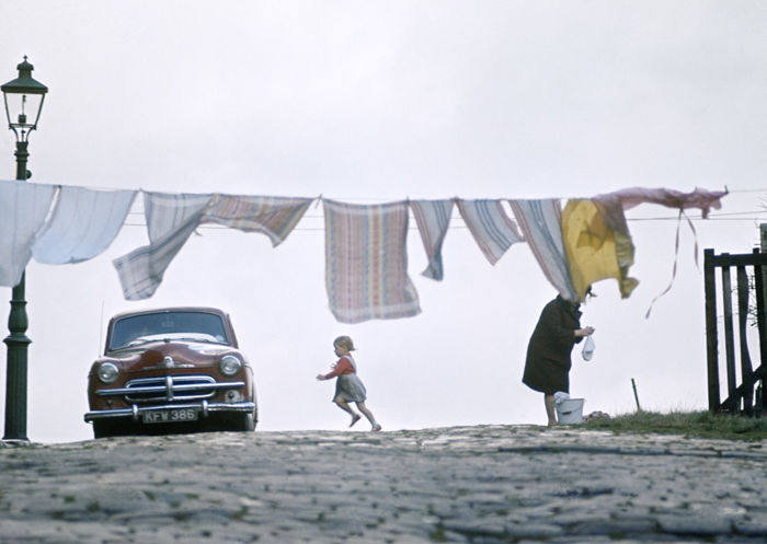 John Bulmer (1938-)  - North UK, Lady, car and washing line, 1964