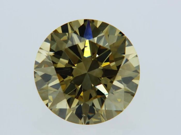 1 pcs Diamant - 0.91 ct - Rond - fancy brownish yellow - VS2