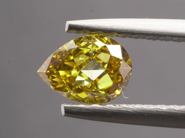1 pcs Diamanten - 0.57 ct - Pear Brillant - fancy intens brownish yellow - SI1- No reserve
