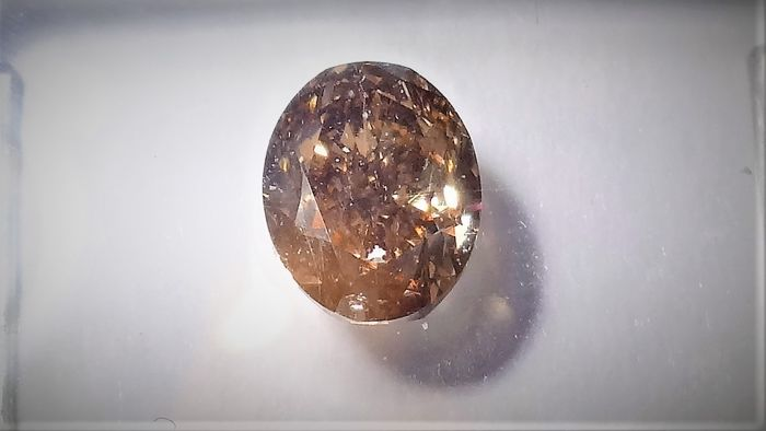 1 pcs Diamant - 1.06 ct - Ovaal - Fancy - fancy orangy brown - SI2