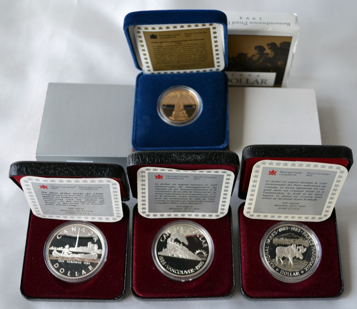 Canada - Dollars 1984, 1985, 1986 and 1994 'Voyageur, Moose, Steam Train, Remembrance Day' (4 pieces)