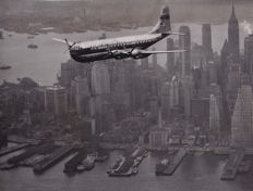 Unknown/ P.A Reuter - Pan-American Clipper against the New York Skyline, 1949