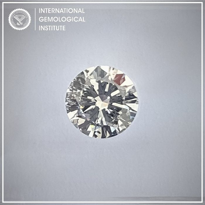 Diamant - 0.70 ct - Rond - E - P1