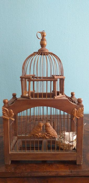 Two antique wooden bird cage with two decorative doves and