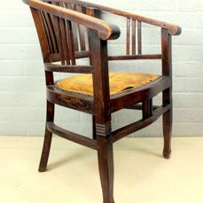 A wooden office chair with leather seat - Leather, Wood