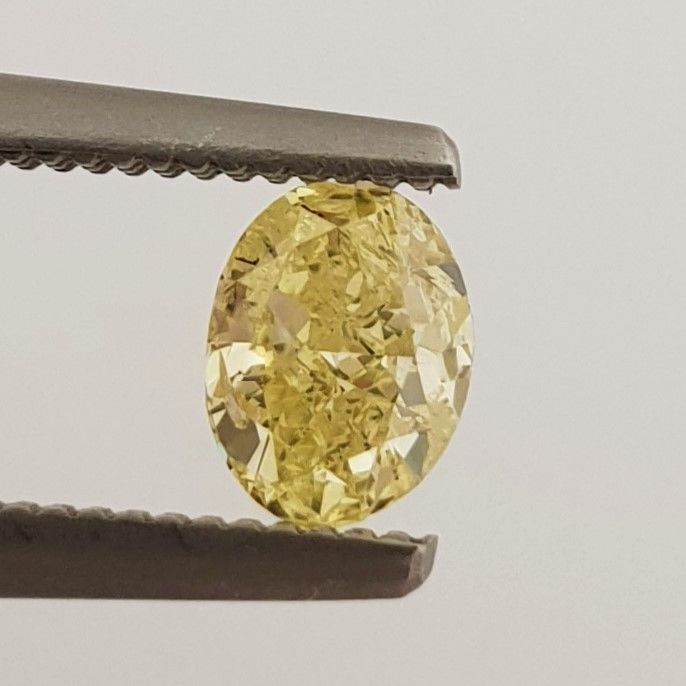 Diamond - 0.52 ct - Oval - Natural Fancy Intense Yellow - SI1