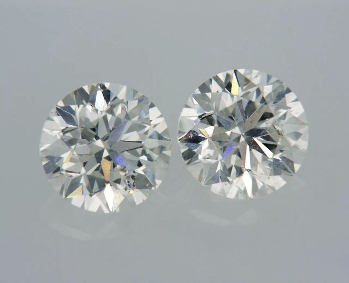 2 pcs Diamantes - 1.01 ct - Redondo - F, G - SI1