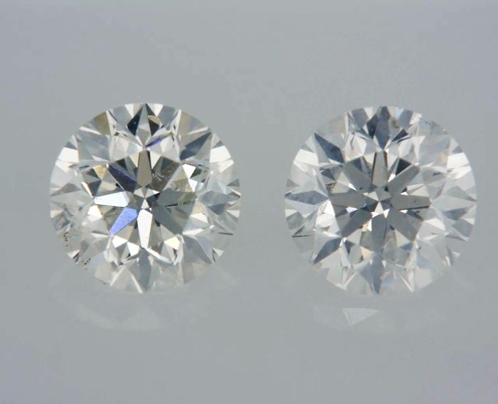 2 pcs Diamanten - 1.06 ct - Rund - F, G - SI1