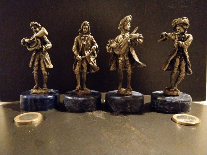 4 Statuettes of musicians in solid silver