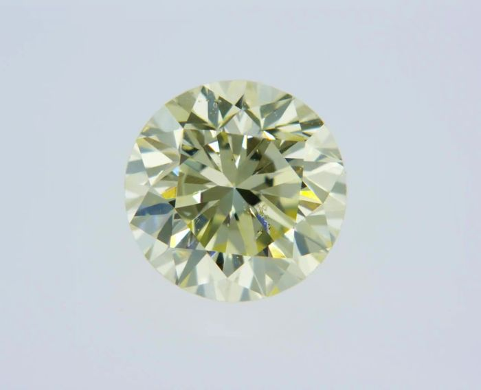 1 pcs Diamant - 0.74 ct - Rond - Q to R Range - SI2