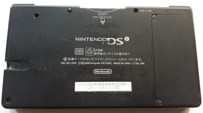 Nintendo DSi (Japanese import) Black console with 10 games