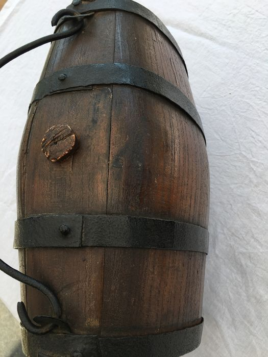 Old barrel in wood and wrought iron used for Whiskey storage