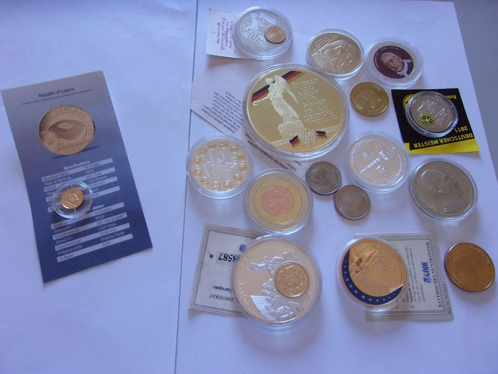 1,24 grammes   gold & a lot of coins  - Gold