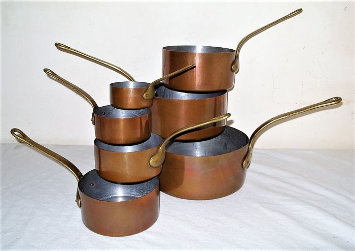 A set of 7 real French pans - solid copper, brass