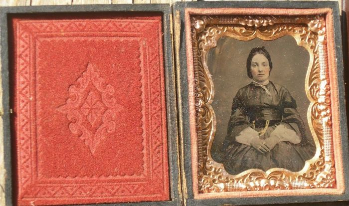 with ambrotype - Very old portrait frame of a lady, - Leather