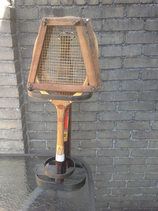 Old racket holder including two vintage rackets, - wood, wrought iron.