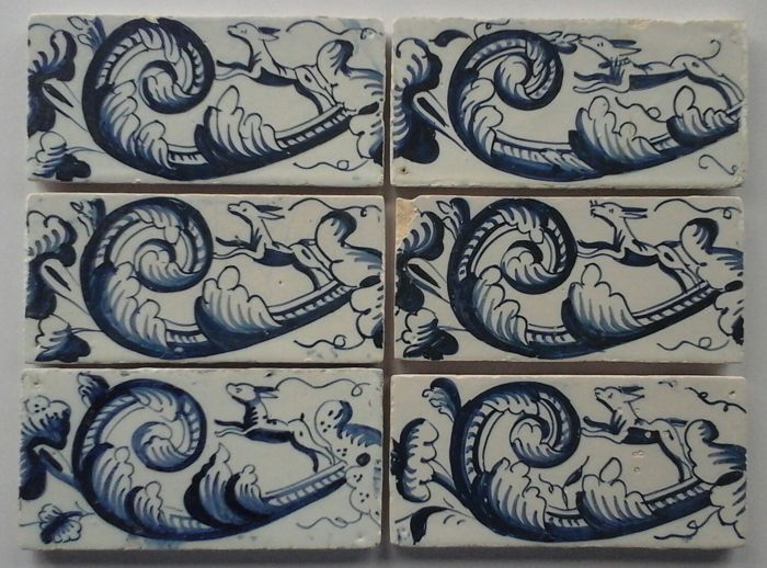 6 pieces of Border Tiles with Dogs. - Ceramic