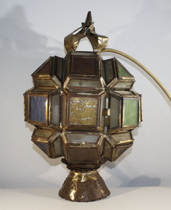 A wall lamp with different colors of glass panes