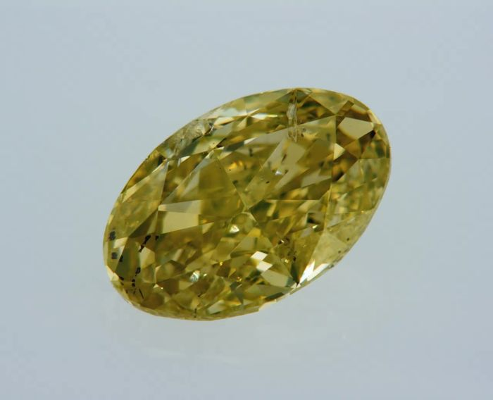 1 pcs Diamant - 1.41 ct - Oval - fancy vivid yellow - SI1