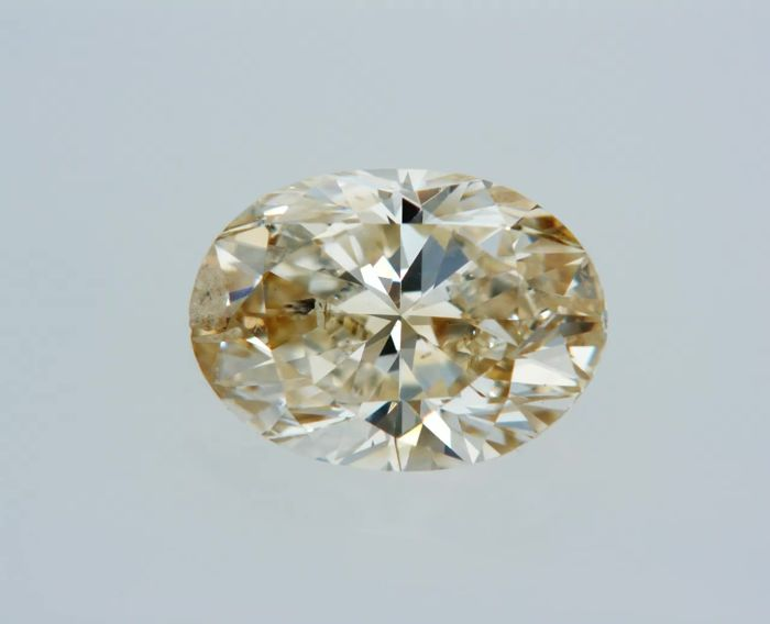 1 pcs Diamond - 1.00 ct - Oval - fancy light orangy brown - SI1