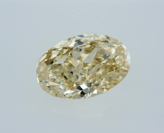 1 pcs Diamant - 1.01 ct - Ovaal - fancy yellow - SI1